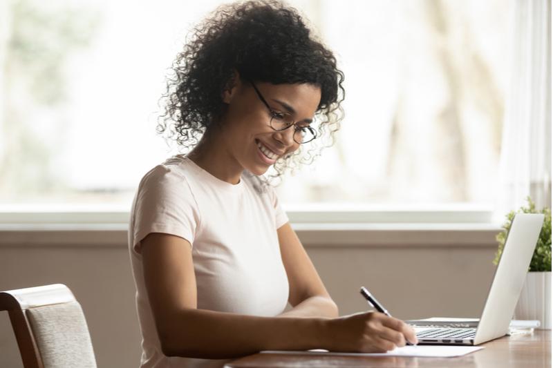 woman smiling on laptop