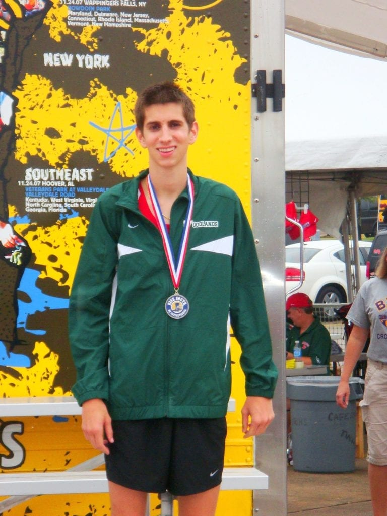 young man with a medal