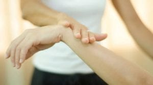 woman touching another persons wrist