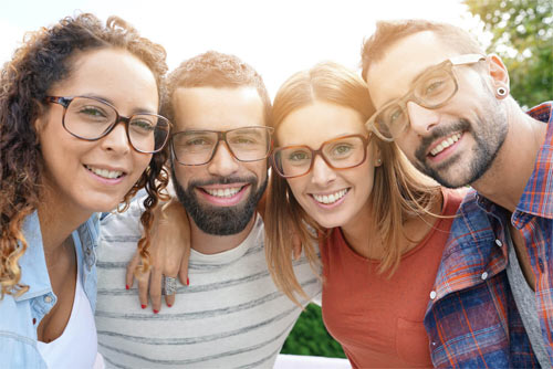 Group of people smiling with glasses