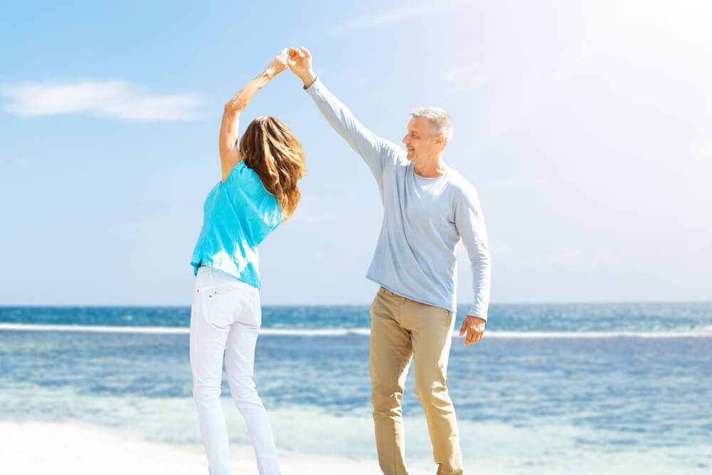 older couple on Florida beach carefree